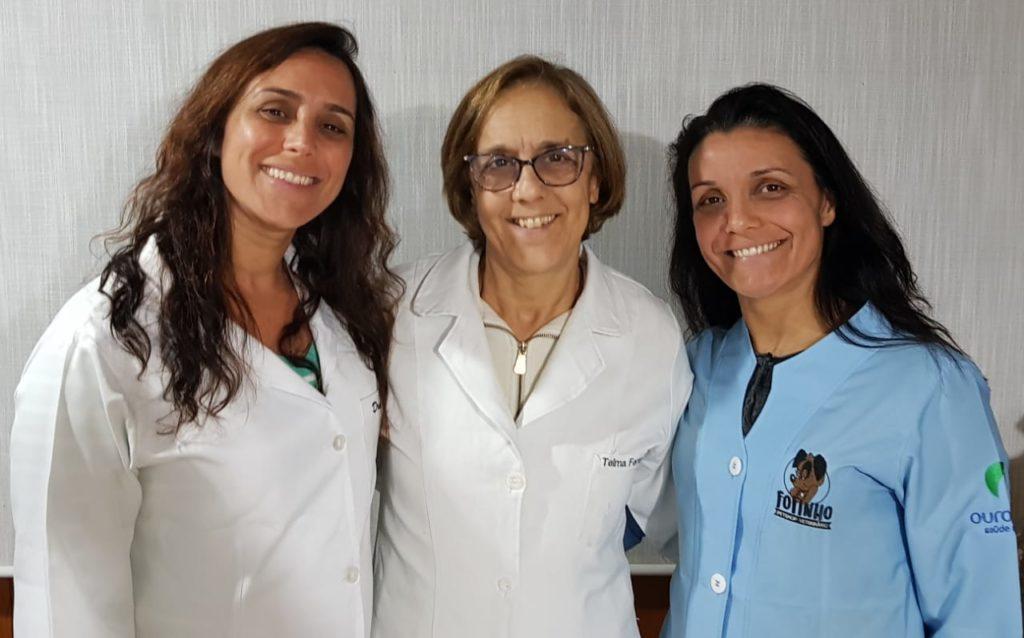 Fundadora Telma Ferrante entre suas filhas Tatiana e Patricia